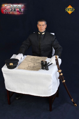 Black wood table with white tablecloth and Pacific map